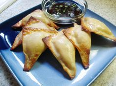 Baked Crab Rangoon16 ounces (low fat cream cheese)   1 (6 ounce) can crabmeat, drained and flaked   4 -5 green onions, thinly sliced   1 garlic clove, minced   2 teaspoons Worcestershire sauce   1 teaspoon soy sauce   1 (48 count) package wonton skins   1/4-1/2 cup melted butter   425 12 min