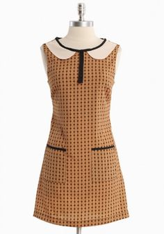 Retro dress. Reminds me of a library in the best way possible.