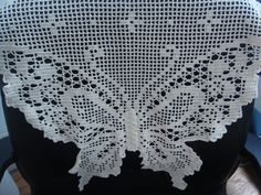 I won this butterfly crochet doily and now it's on the back of my chair :)