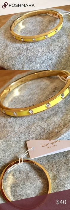 """Gorgeous kate spade bracelet ♥️ NWT ♥️ Golden bangle with a beautiful yellow """"polish"""" all around and clear gemstones equidistantly placed throughout. So pretty ♥️ kate spade Jewelry Bracelets"""