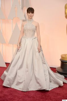 Felicity Jones in Alexander McQueen at the 2015 Oscars.  She is gorgeous and her makeup is lovely but I HATE this dress.
