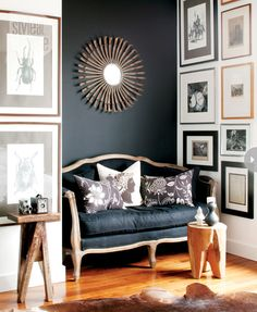 art grouping + black settee + sunburst mirror + chalkboard wall + wood details