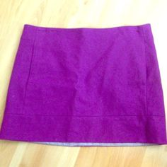 Jcrew felted mini skirt Deep purple felted mini skirt with front pockets, back zip, back darts, and fully lined. Super mod chic! Looks great with tights and clogs with a sweater! J. Crew Skirts Mini