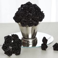 Ribbon Roses - Black - 144/pk | eFavorMart / Soft, smooth and glistening satin ribbon is used to craft adorable roses on a 3 wired stem which is wrapped with the satin cloth to ensure maximum softness. These brilliantly hand rolled satin ribbon flowers are perfect to use in all varieties of crafting, favor making, gift adornments, party decoration and many other embellishing activities. Use these shiny tokens of love and beauty to add an instant visual element into your decorations and…