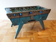 vintage foosball table. Laaaarve this! Would love to get one of these for my niece and nephew... or even one for home too! The fact that it is turquoise is an added bonus! :)