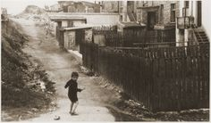 A Jewish boy walking in the back alley in the Bedzin ghetto. [Photograph #08130]