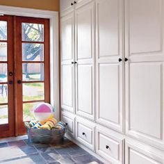 Pass-through Mudroom for Quail Ridge. For the functionality of a mudroom with the look of a simple backdoor, hide everything behind clean white cabinets. Consider organizing the space by family member rather than by item. (Photo: Laurey W. Built In Cabinets, Storage Cabinets, White Cabinets, Diy Cabinets, Mudroom Cabinets, Cupboards, Clean Cabinets, Tall Cabinet Storage, Armoire Entree