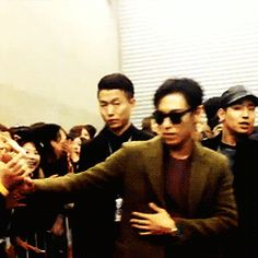 JPEG T.O.P. being so cautious with his fans. Unlike GIF Taeyang...xD