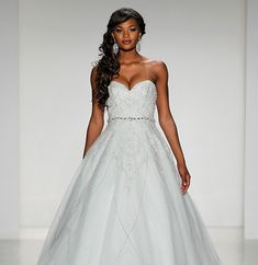 2015 - Alfred Angelo Collection - Tiana—Ambitious, confident, and determined, Tiana is the sophisticated bride who likes a touch of jazzy fun. This strapless gown sparkles with the glitter and excitement of New Orleans and is adorned throughout with delicate embroidery and crystal beading that is reminiscent of the princess' signature flower, the lily.