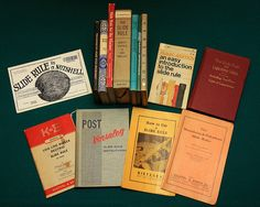 Takes me back to my misbegotten (and math-challenged) youth.  Slide Rule Books by Velo Steve, via Flickr