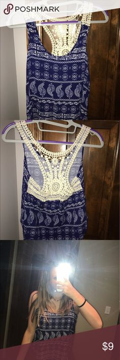 Summer lace patterned blue tank top lace at the top, blue patterned down tank top. Super cute for summer. Got it last summer and haven't worn it yet. No tags but brand new. great condition. Looking for a new home! Feel free to make an offer. From rue 21. Rue 21 Tops Tank Tops