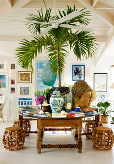 Tropical style with rattan and blue and white ceramics to dress it up. Bright art adds to the sense of place /resort decor/ tropical