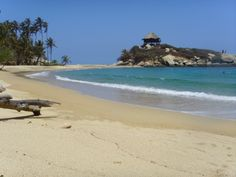 Parque Tayrona- a pristine beach next to a jungle in Colombia on the Caribbean Coast.