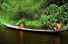 Indigenous peoples of the Americas - A Venezuelan Warao family traveling in their canoe.