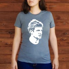 Throw this shirt on and walk out the door looking awesome. This black shirt is 100% cotton. It displays Thomas Müller, one of the greatest soccer