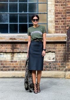 Graphic tee and skirt, street style. Forrest green and black, black skirt, pencil skirt, scrappy shoes, scrappy heels, sunglasses, black sunglasses. Fall style. Fall fashion.