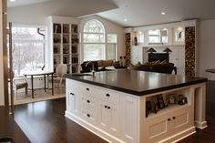 Huge kitchen island, black and white, by Heather Scott Designs of Brookfield, Wisconsin
