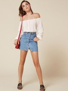 It's summer - show some shoulder. This is an off-the-shoulder, cropped top with an elastic neckline and buttons down the front.