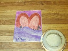I drew a heart inspired sunset scene on the front of my handmade Valentine's Day card.