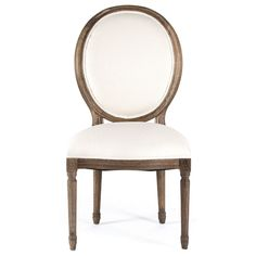 This chair features a beautiful French country inspired design. The round medallion back and seat are upholstered in white cotton and the oak frame is finished in traditional oak. Includes: One (1) Ch