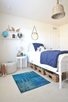 Little boy's room in white and blue with natural woven accents and turquoise Sukhi overdyed rug Turkish patchwork rug via Suburban Bitches