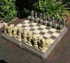 Large stone chess set with whimsical spin offers beautiful form and function as handcrafted garden art. For year-round outdoor use, the traditional board game helps create an inviting and relaxing spo