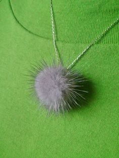 """Touch of Chinchilla"" faux silver chinchilla puff necklace on a real silver chain. Great for the holidays with its silver color."