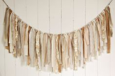 Rag Tie Banner, Burlap, Lace, Linen, Champagne, Ivory, Rag Tie Garland, Fabric Garland, Photo Prop, Wedding, Bridal Shower, Nursery, Custom Beautiful shabby chic rag tie banner made with many types of high-quality fabric and textures including cotton blends, lace, burlap, linen, chiffon, and organza. My banners have a shabby chic feel with slightly frayed edges. My standard banner is 5 feet in length with 2 feet of jute on each end for tying. The strips of fabric hang about 17 inches once…