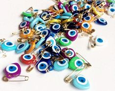 Evil eye safety pins | Etsy AU Wedding Favors For Guests, Unique Wedding Favors, Unique Weddings, Eye Safety, Safety Pins, Evil Eye Charm, Evil Eye Bracelet, Color Mixing, Resin