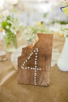 Wood Wedding Table Numbers - nailing down the wedding decor... literally - #CowgirlWedding