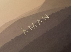 Brand identity and gold foiled brochure cover for luxury resort business Aman by Construct, United Kingdom
