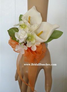 You will receive a Beautiful handmade Orange and White Calla Lily Wedding Flowers or Special Events Wrist Corsages.