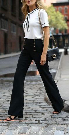 Sailor vibes white tie neck knit top with black piping navy sailor inspired button front pants black ankle strap block heel sandals classic leather crossbody bag gucci st john tahari steve madden statement pants creative office style workwear wear to work Fashion Mode, Office Fashion, Work Fashion, Fashion Outfits, Fashion Fashion, Classy Fashion, Fashion Black, Classic Fashion Style, Fashion Ideas