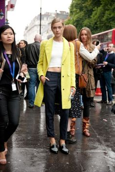 Shop this look on Lookastic:  http://lookastic.com/women/looks/yellow-overcoat-and-white-cropped-top-and-navy-dress-pants-and-grey-loafers/1217  — Yellow Coat  — White Cropped Top  — Navy Dress Pants  — Grey Leather Loafers