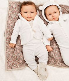 Soft and playful sets and hooded one-pieces keep our babies warm, cute and comfy this season.