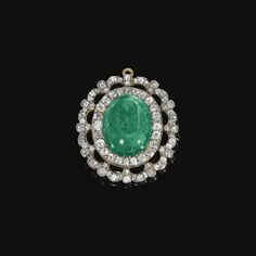 PROPERTY FROM THE ESTATE OF THE LATE PRINCE KINSKY  - Emerald and diamond pendant, circa 1870 - Centring on a cabochon emerald framed with circular- and single-cut diamonds.