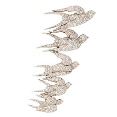 Edwardian Diamond Flock of Swallows Pin | From a unique collection of vintage brooches at https://www.1stdibs.com/jewelry/brooches/brooches/