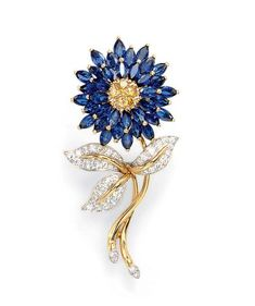 A SAPPHIRE AND COLORED DIAMOND BROOCH, BY OSCAR HEYMAN & BROTHERS   Set with a pavé-set yellow diamond bombé pistil, extending three tiers of marquise-cut sapphire petals, to the gold and diamond stem, with circular-cut diamond leaves, mounted in platinum and 18k gold  By Oscar Heyman & Brothers, no. 74724
