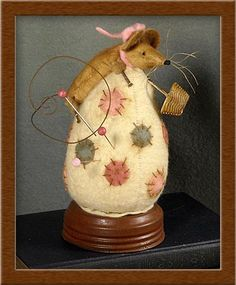 """A wool felt egg pin-keep with a little muslin mouse attached who is ready for the annual Easter """"Egg Hunt"""".  Design by P.K. Gracia."""