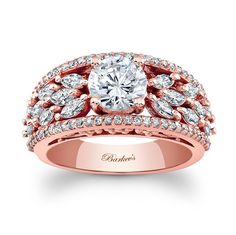 This modern rose gold engagement ring/diamond wedding band features a round diamond center embellished on the shoulders with marquise cut diamonds cascading down the sides. A ridge of diamonds frame the shoulders for an elegant touch of glamour. Indian Wedding Rings, Indian Engagement Ring, Rose Gold Engagement Ring, Vintage Engagement Rings, Diamond Wedding Bands, Solitaire Ring Designs, Gold Ring Designs, Gold Earrings Designs, Vintage Wedding Jewelry