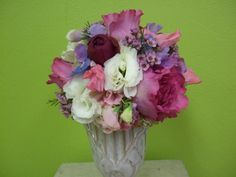 Pink peonies add a delightfully fragrant touch to this bouquet that also features white lisianthus, lavender and pink sweet pea, red and pink roses, and pink waxflower.  Wedding Bouquets - Jeff Martin's Florist