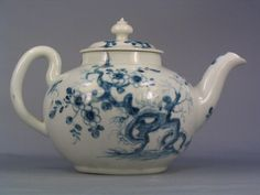 Description: Worcester porcelain teapot and cover; Globular with S-shaped spout, loop handle and low domed cover painted in underglaze blue with the ??? root pattern Materials: porcelain Accession number: NWHCM : 1946.70.243