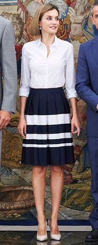 Queen Letizia attends audiences at the Zarzuela Palace on September 2, 2015.  Queen Letizia opted for a familiar outfit, one she has worn on four previous occasions, which has become somewhat of a uniform for attending audiences. The ensemble consists of the Hugo Boss 'Marela' striped skirt and Hugo Boss 'Bashina' white shirt and TOUS cultured freshwater pearl drop earrings. There was a slight variation to the outfit with the new addition of Prada nude pointy-toe patent pumps (US$650).