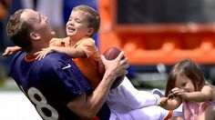 Everyone knows the first rule of Denver Broncos training camp: Do not tackle Peyton Manning . Try telling that to Peyton's three-year-old son, Marshall Williams Manning. Denver Broncos Football, Go Broncos, Broncos Fans, Tennessee Football, Football Girls, Football Stuff, Pittsburgh Steelers, Dallas Cowboys