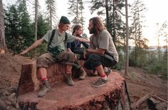 Earth First environmental activists sit atop the stump of an old-growth coast redwood tree that was cut down by a logging company on Sept. 28, 1996, in Headwaters Forest, Calif.