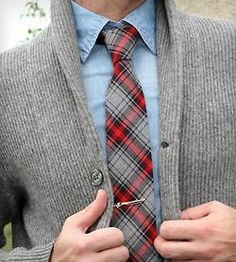 This outfit is amazing. He could have stopped with the denim shirt, but the tie adds a whole new layer of depth to the piece