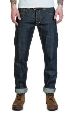 - Style: 1963 Roamer Pant - Fit: Slim fit - Tapered leg - Mid rise - Color: Indigo - Material: 100% cotton - 11oz raw selvedge denim - Sanforized - Heavy honey colored cotton threat - Buttons and rivets in a zinc finish - Heavy bar... Nudie Jeans, Denim Jeans, Honey Colour, Hair And Beard Styles, New Shop, Workout Pants, Indigo, Men's Fashion, Casual Outfits