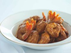 Official Kentucky Derby recipe from Churchill Downs: Our Signature BBQ Shrimp served over Cheddar Cheese Grits