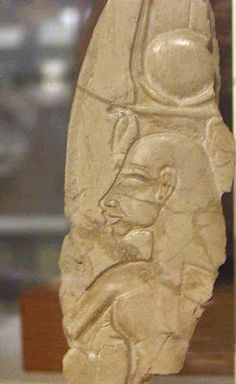 Queen Nefertiti: Fragment of a limestone relief showing Nefertiti wearing disk, horns and feathers, and uraeus. Amarna Period. From the Petrie Museum in London