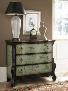 June Sky Chest    Deep, felt-lined drawers welcome your possessions within a bureau inspired by a French mural. Unusual silhouette revives fine custom